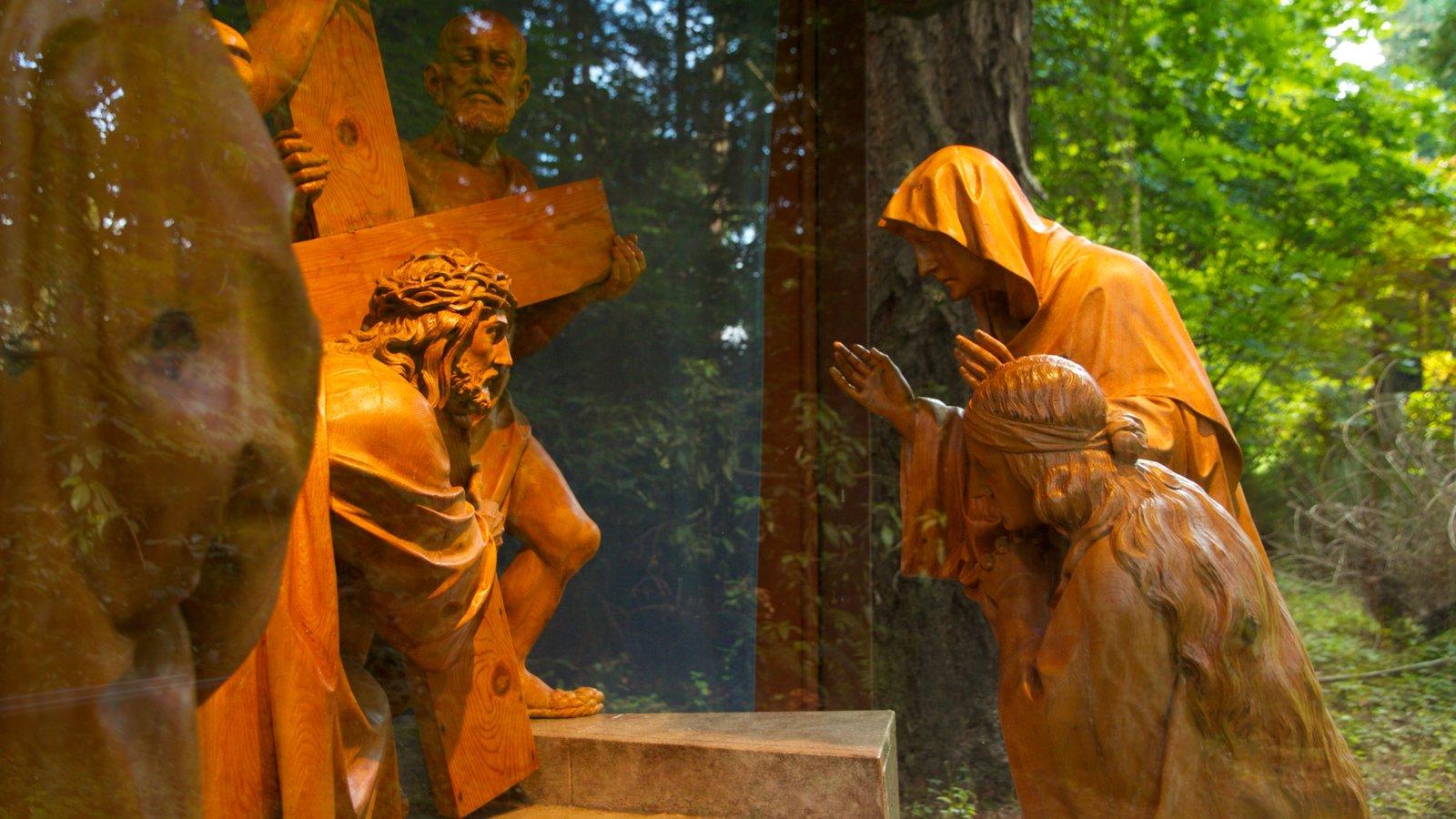 Grotto ofreciendo un parque, arte al aire libre y una estatua o escultura