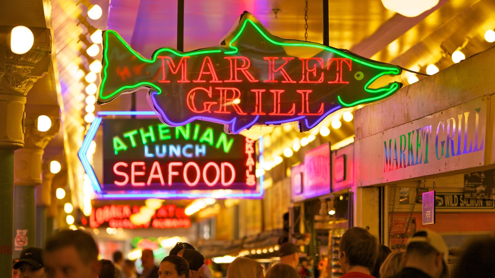 Pike Place Market which includes markets, signage and night scenes