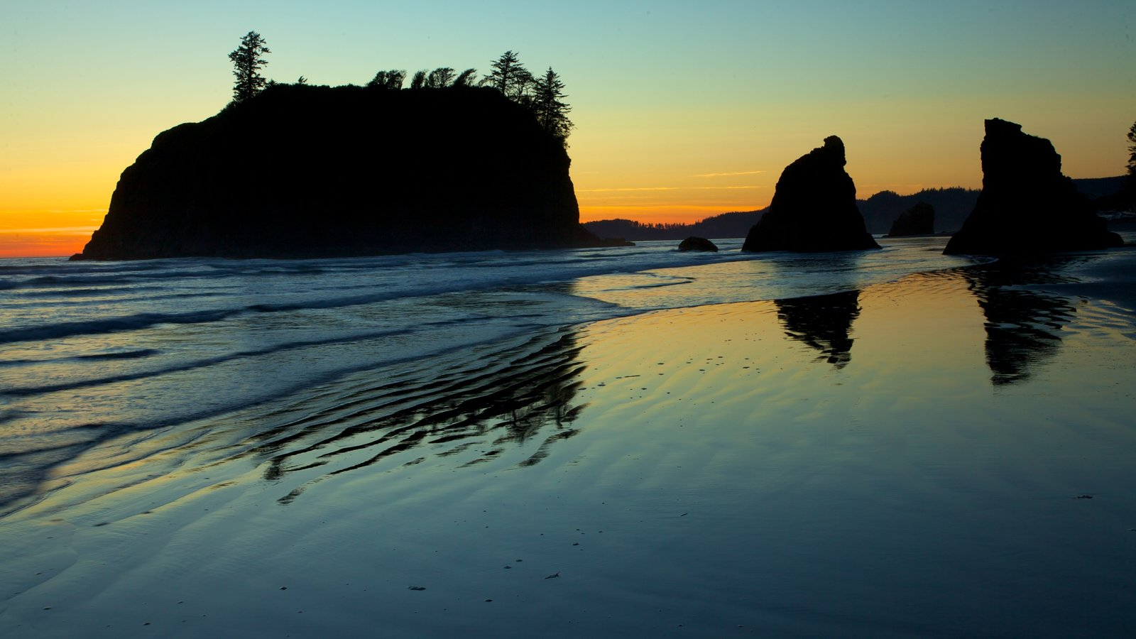 Washington Coast which includes a sandy beach, a sunset and landscape views