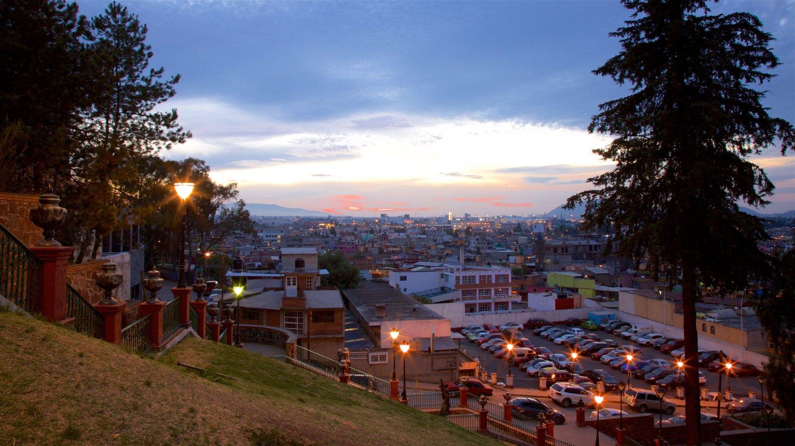 Metepec ofreciendo una ciudad, una puesta de sol y vistas de paisajes