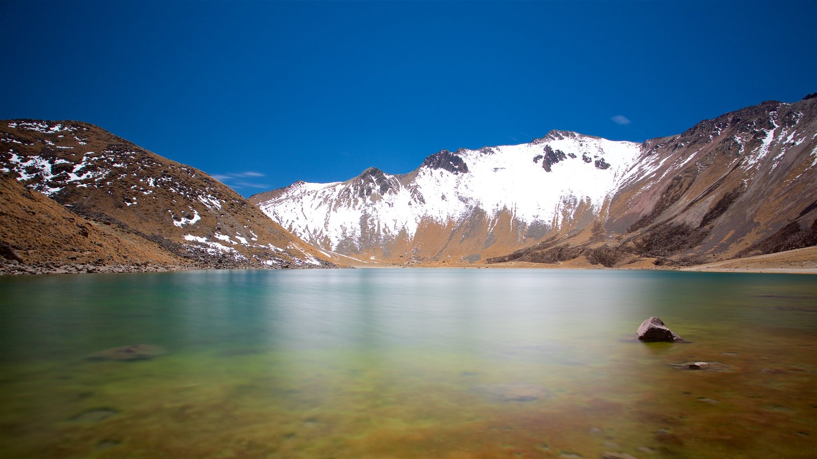 Nevado de Toluca National Park featuring a lake or waterhole, mountains and snow