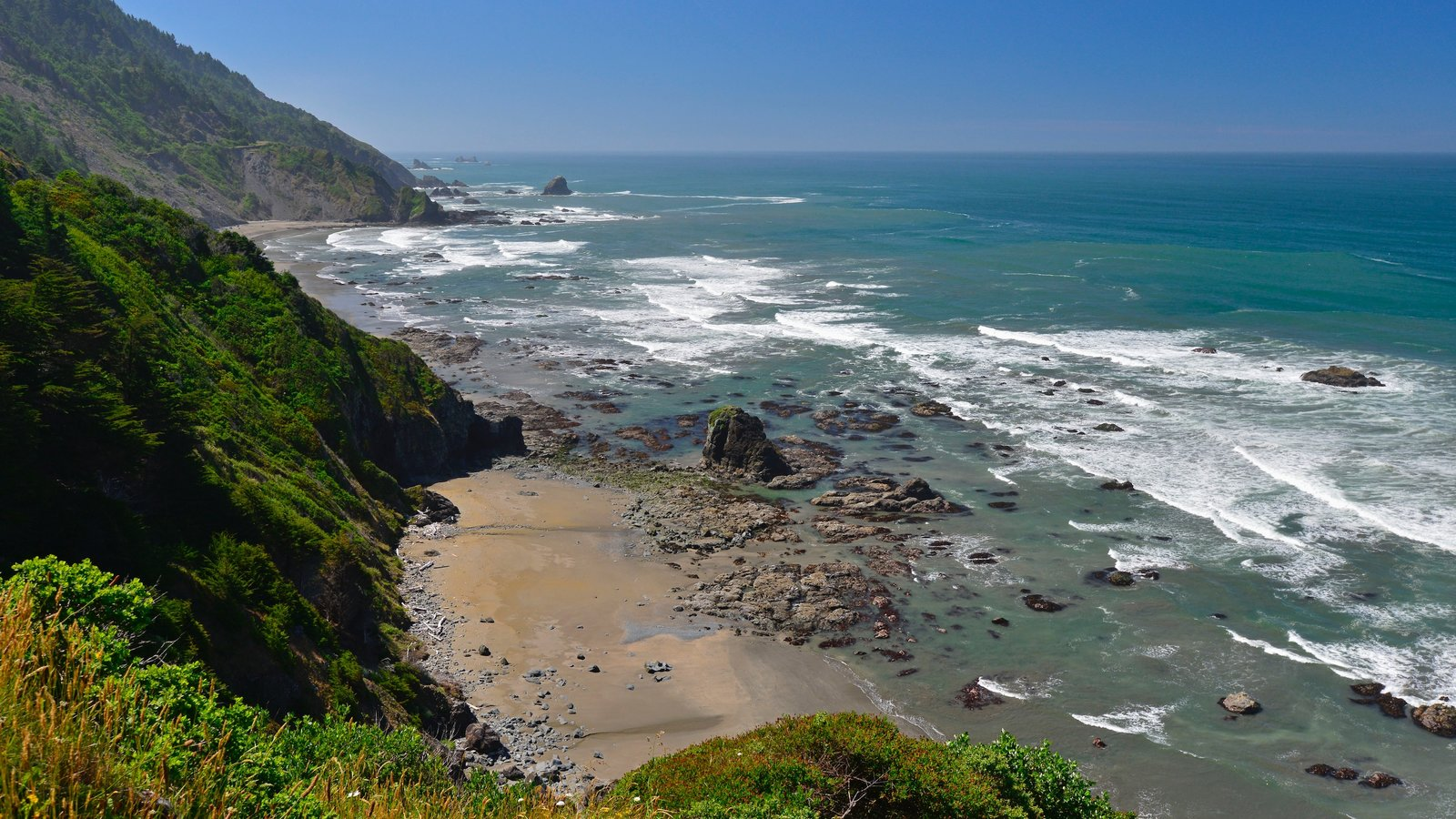 Redwood National and State Parks featuring rocky coastline, general coastal views and a beach