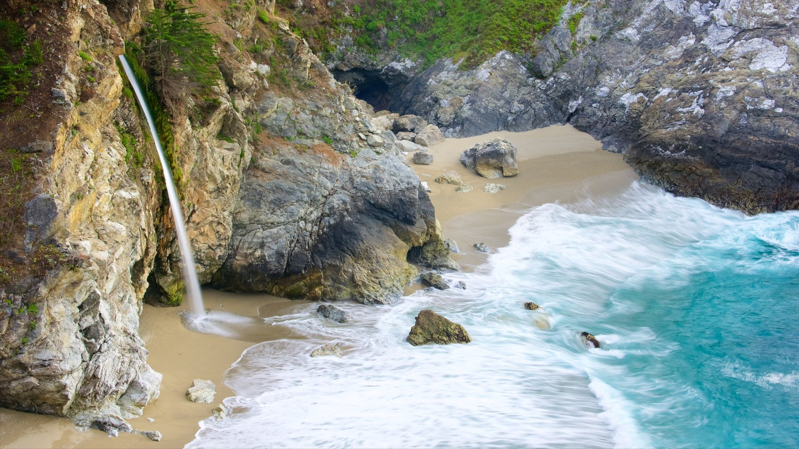 McWay Falls showing rocky coastline and a beach