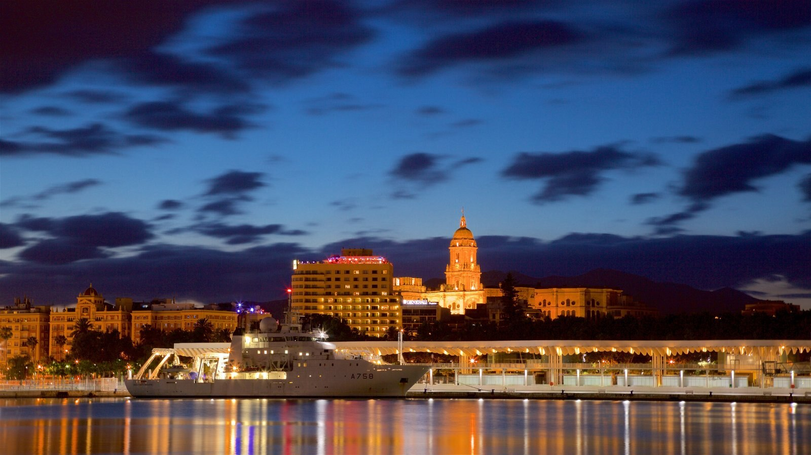 Port of Malaga which includes boating, a city and night scenes