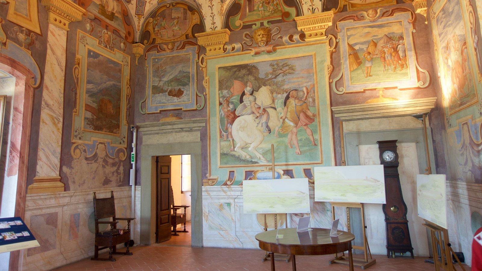 Castiglione del Lago which includes a castle, interior views and art