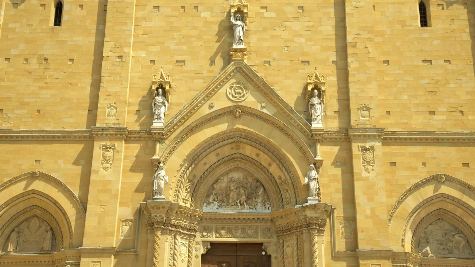 Cathedral of Arezzo showing religious elements and a church or cathedral