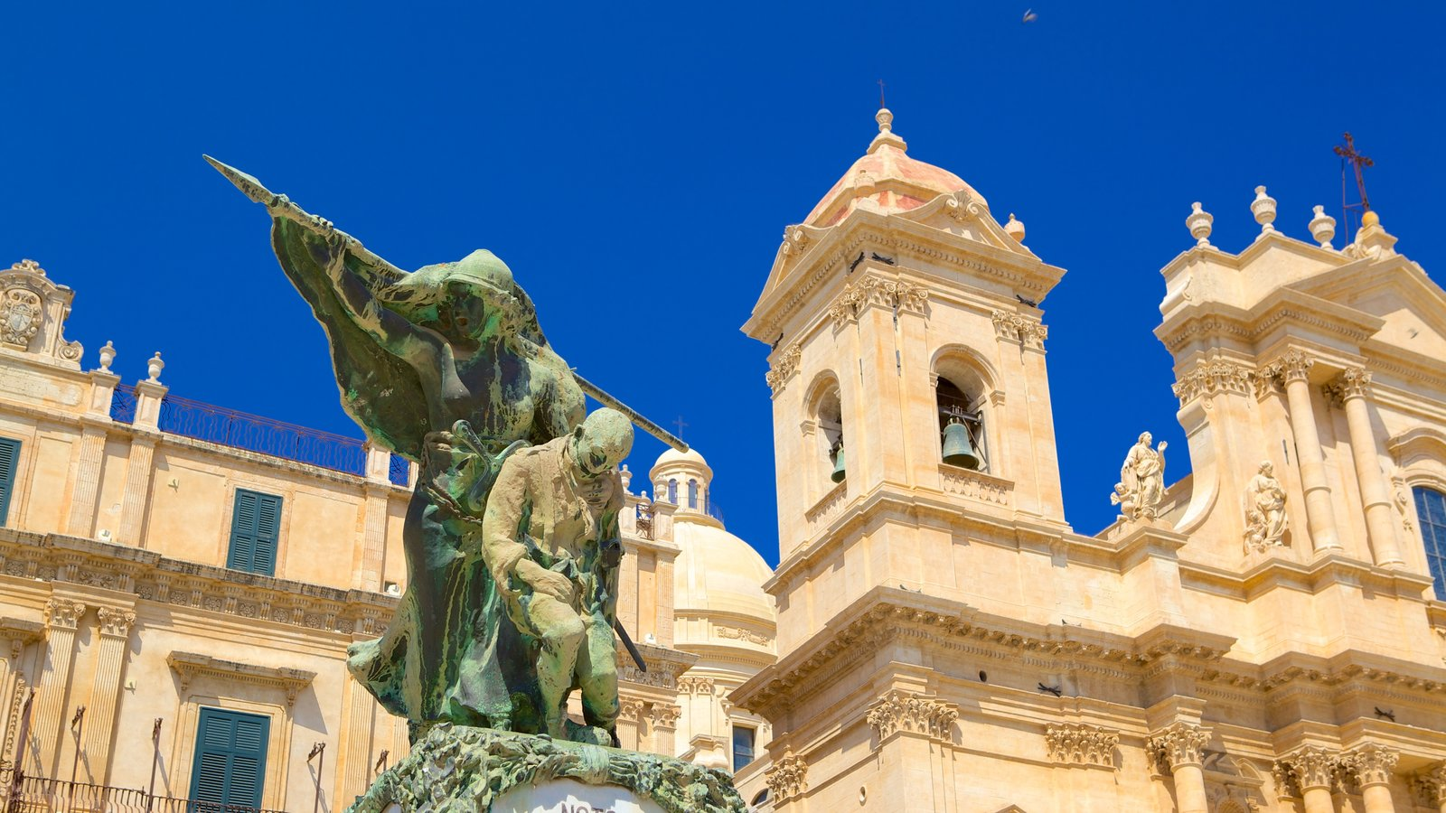 Cathedral of Noto featuring a church or cathedral, religious aspects and a statue or sculpture