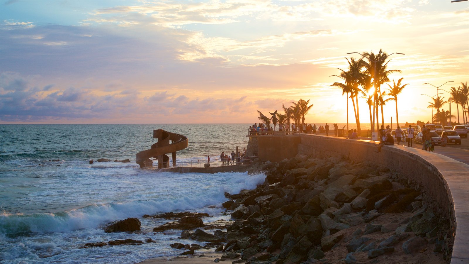 Olas Altas Beach Showing Waves General Coastal Views And A Sunset