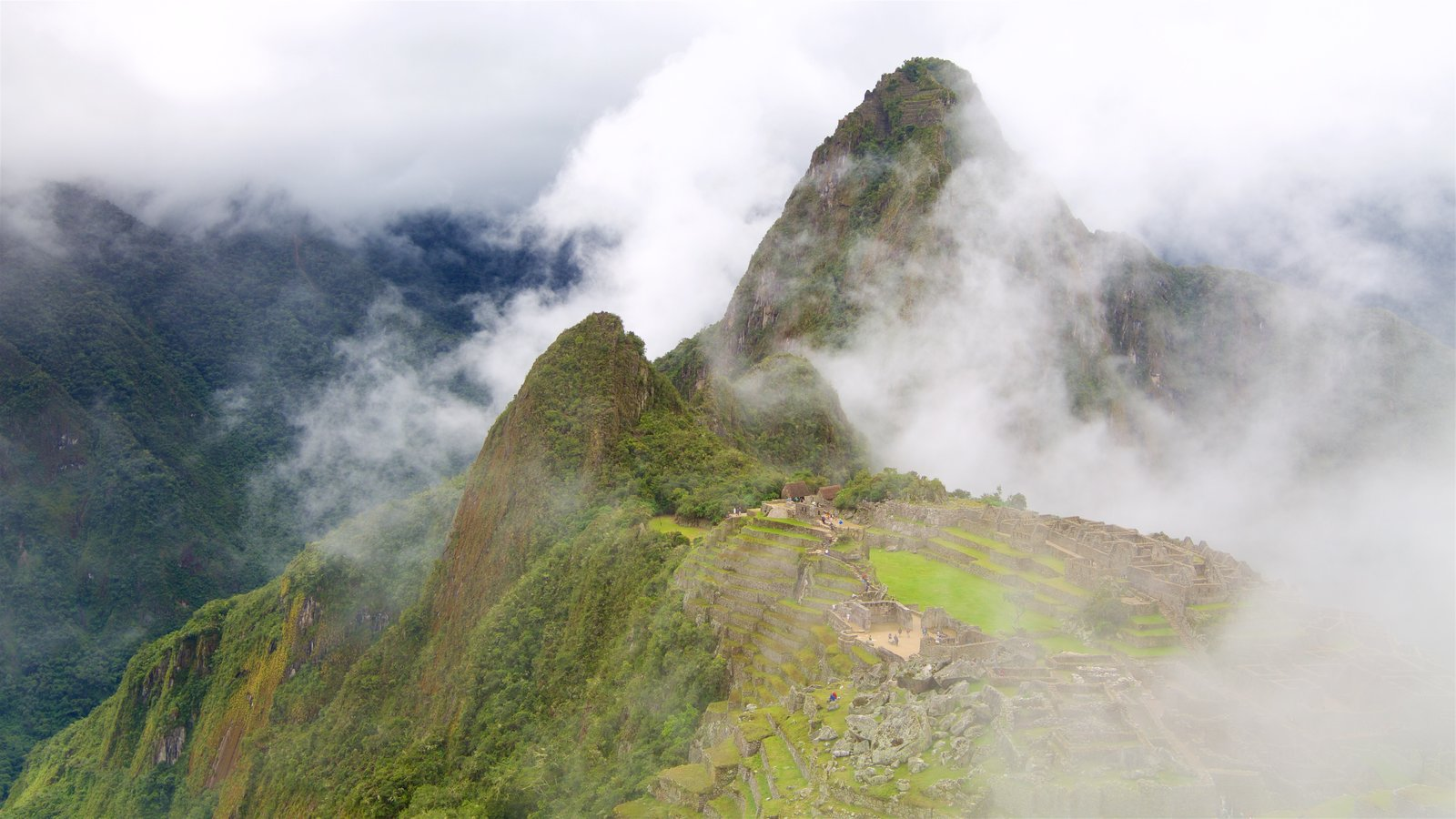 Huayna Picchu featuring mist or fog, mountains and tranquil scenes