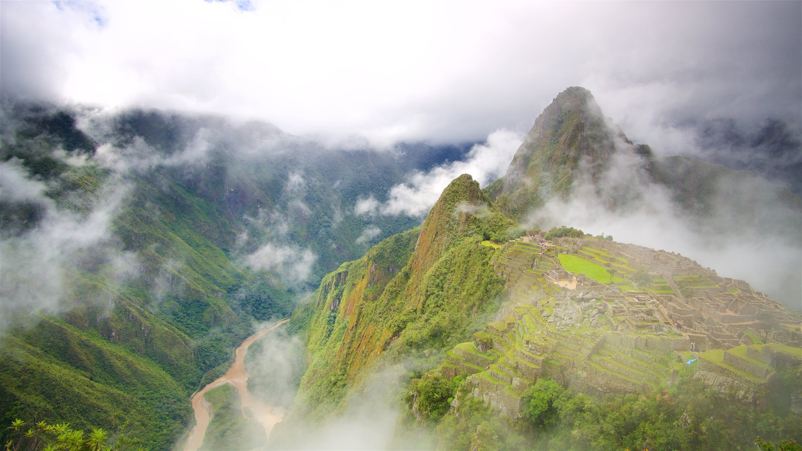 Huayna Picchu which includes mist or fog, tranquil scenes and mountains