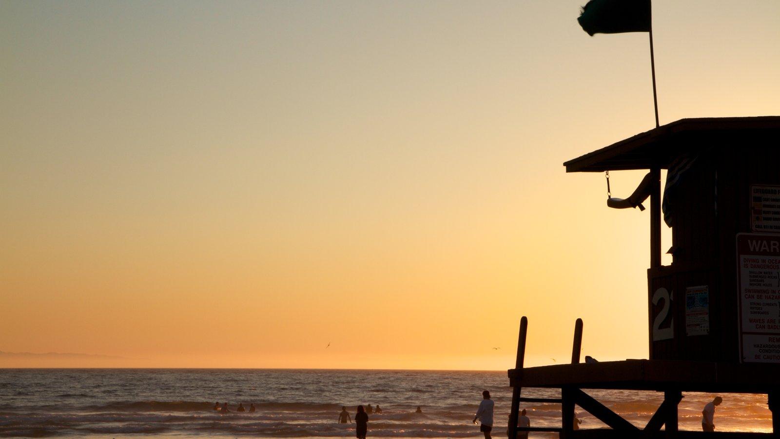 Newport Beach showing a beach, general coastal views and a sunset