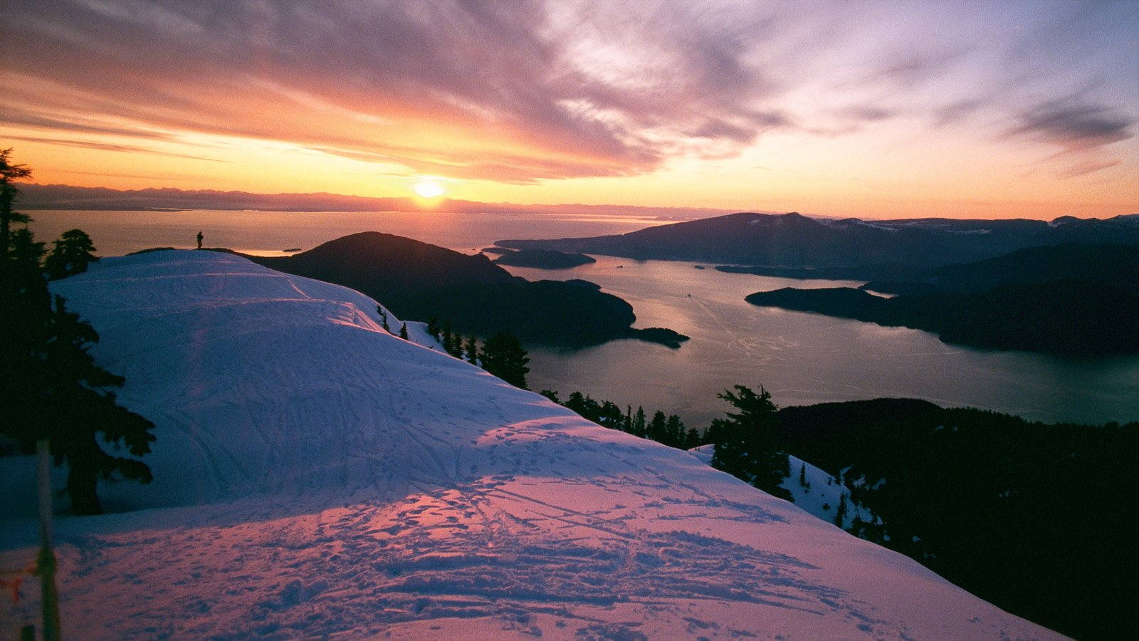 Cypress Mountain showing snow, a sunset and mountains