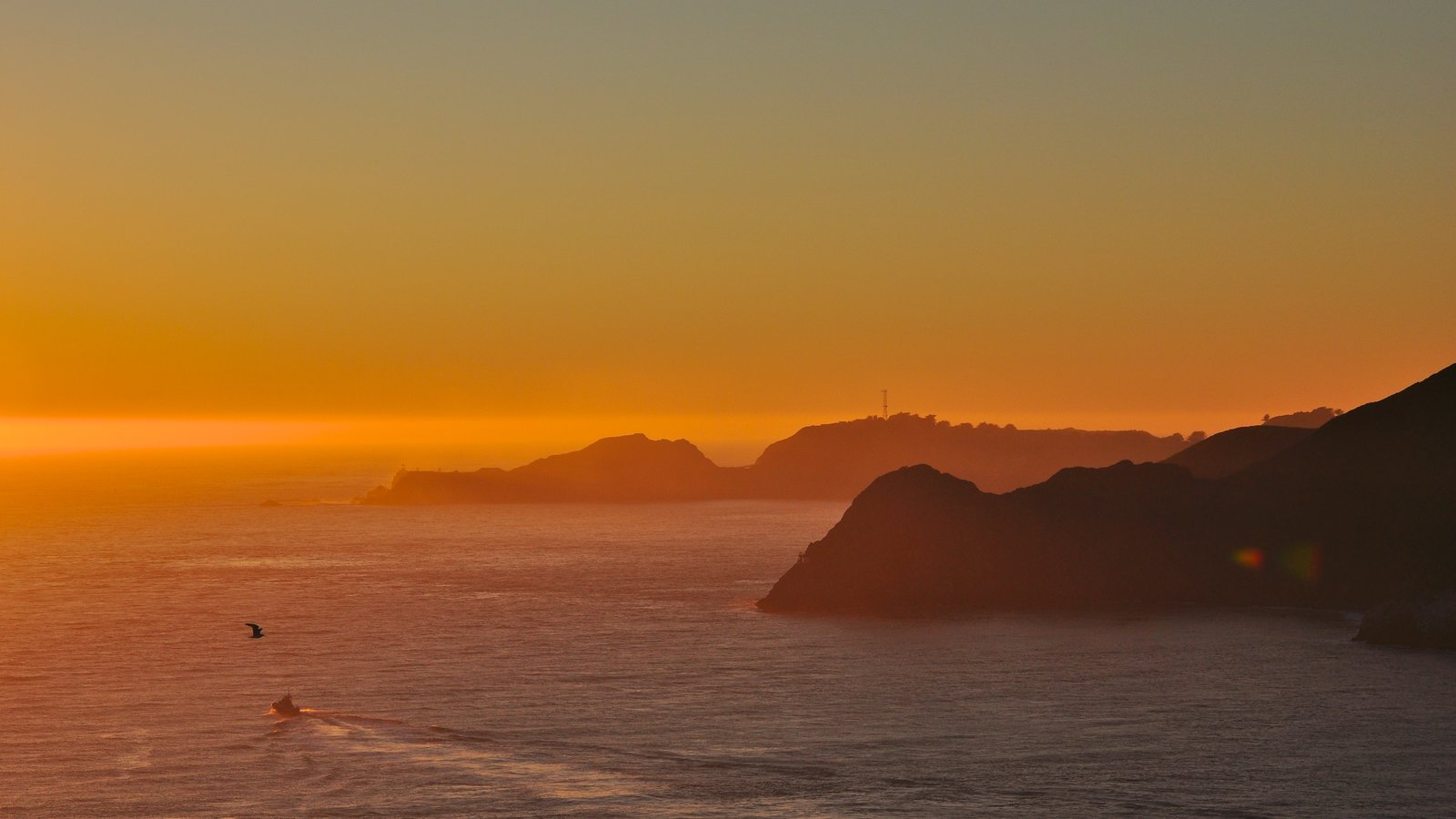 San Francisco showing landscape views, a sunset and a bay or harbor