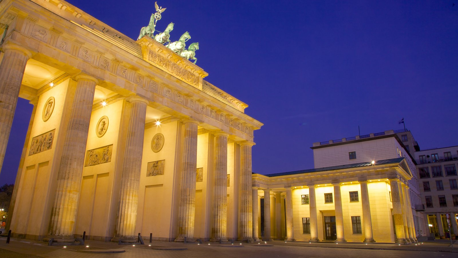 Brandenburg Gate showing night scenes, a city and heritage architecture
