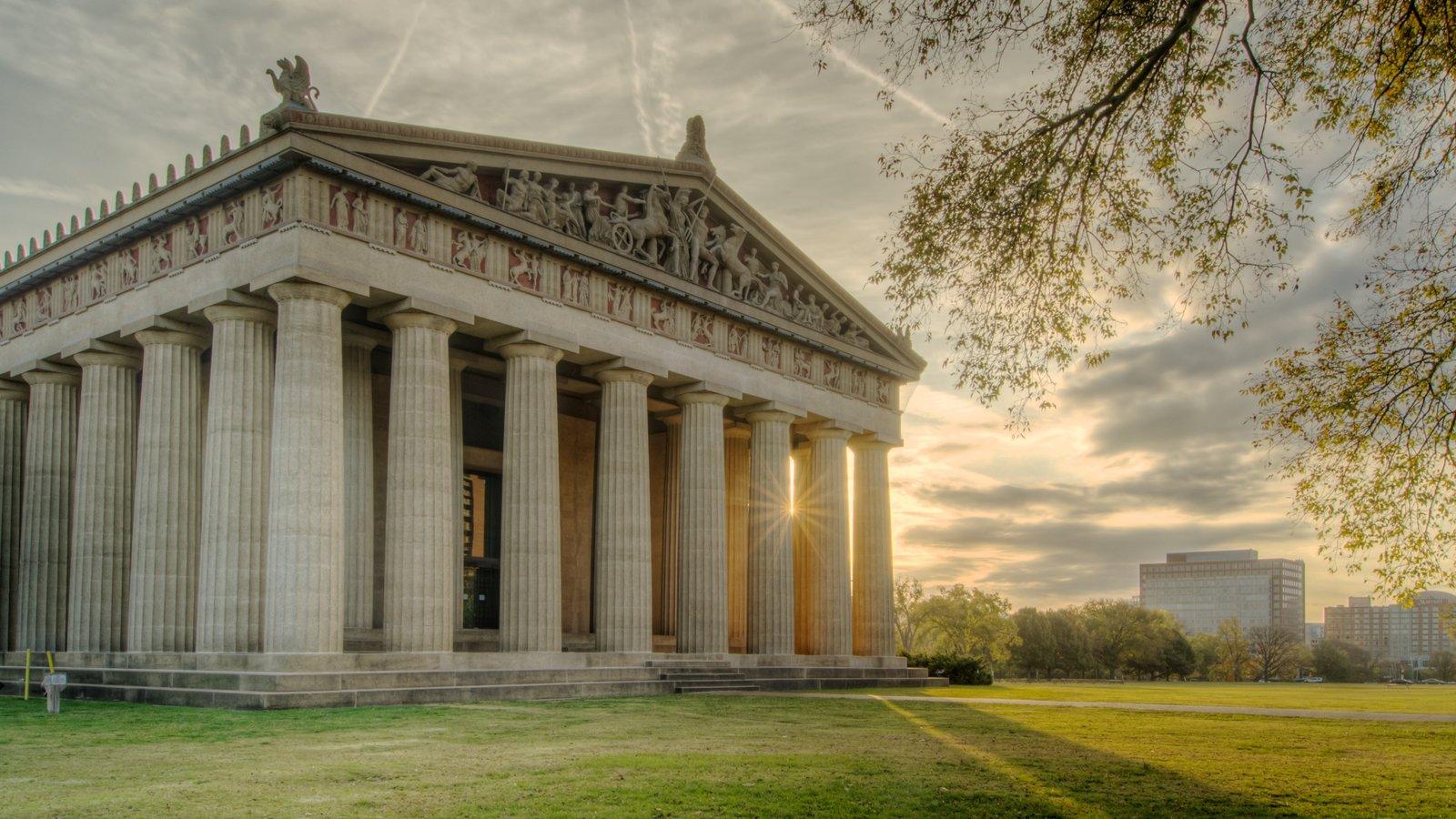 Parthenon que incluye una puesta de sol, una ciudad y patrimonio de arquitectura