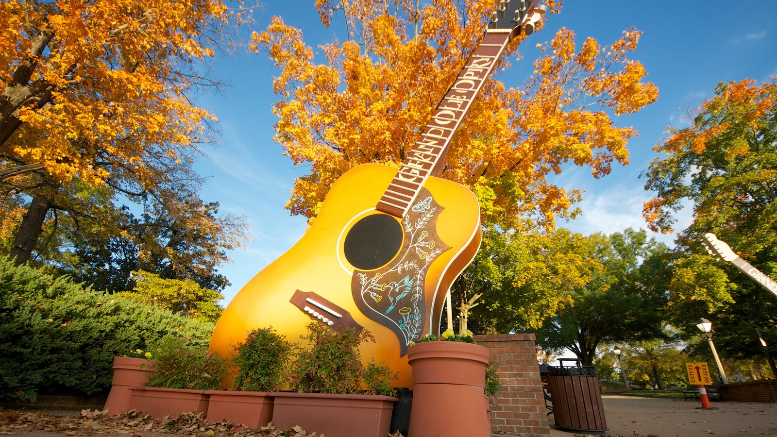 Grand Ole Opry featuring a garden and autumn leaves