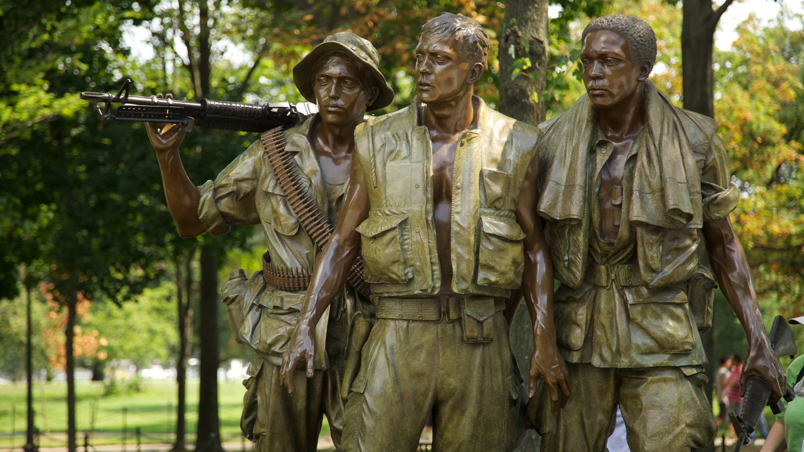 Vietnam Veterans Memorial featuring a statue or sculpture, a memorial and military items