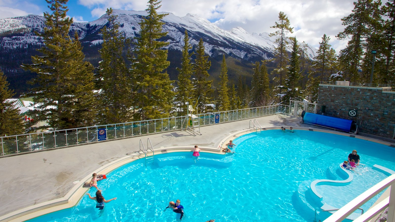 Calgary which includes a pool and tranquil scenes as well as children