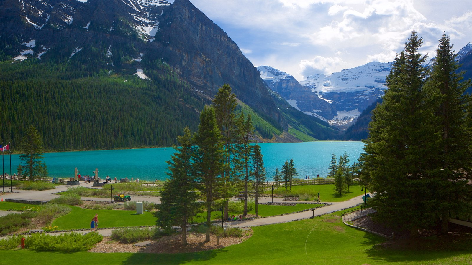 Banff National Park featuring a lake or waterhole, a garden and tranquil scenes