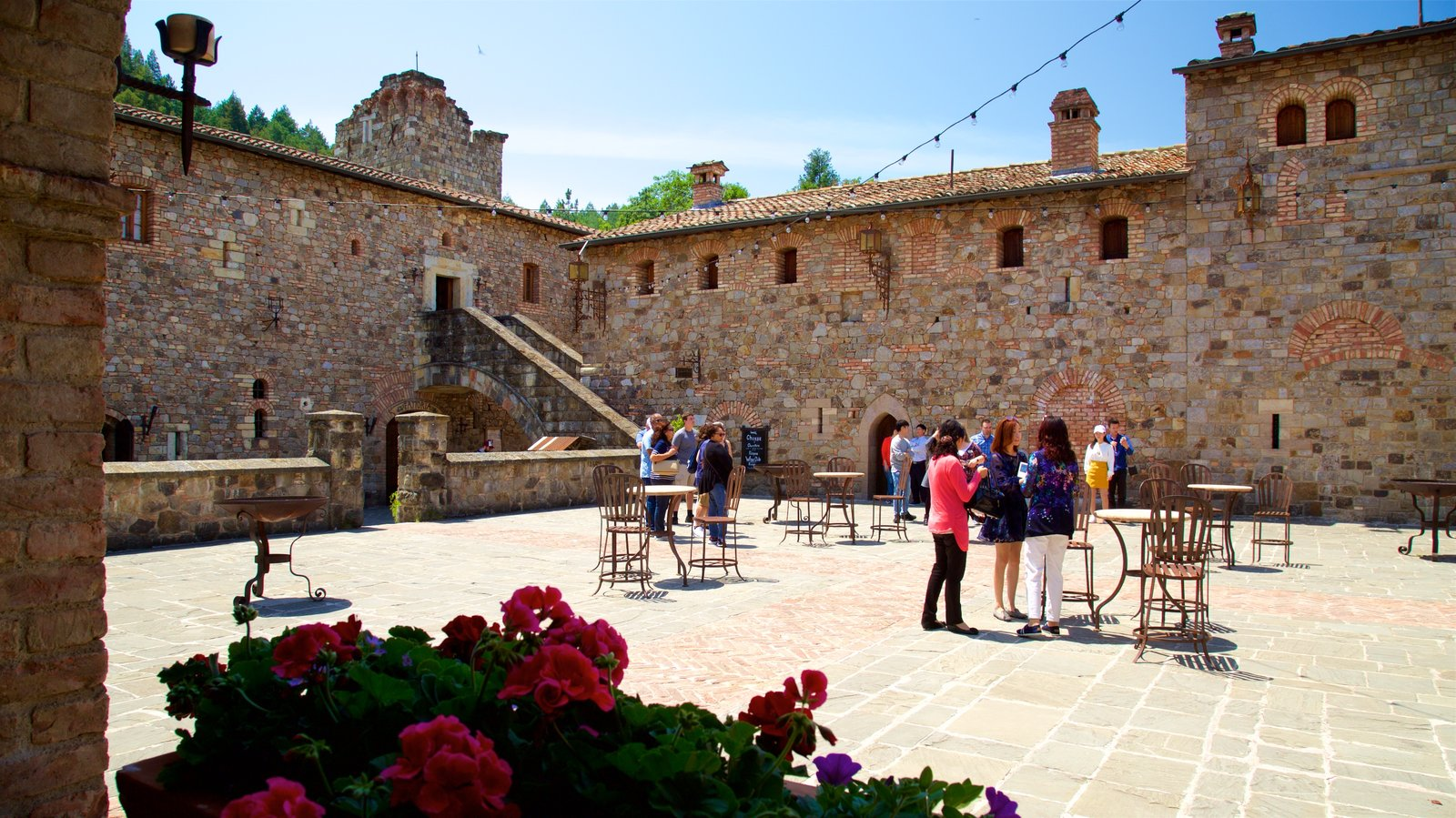 Castello di Amorosa featuring chateau or palace, a square or plaza and flowers