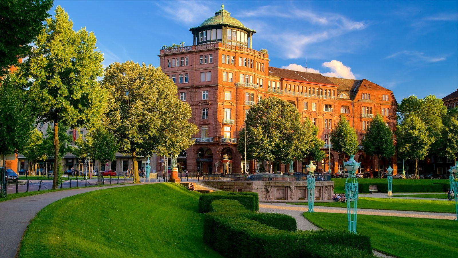 Friedrichsplatz which includes a park, a sunset and heritage elements