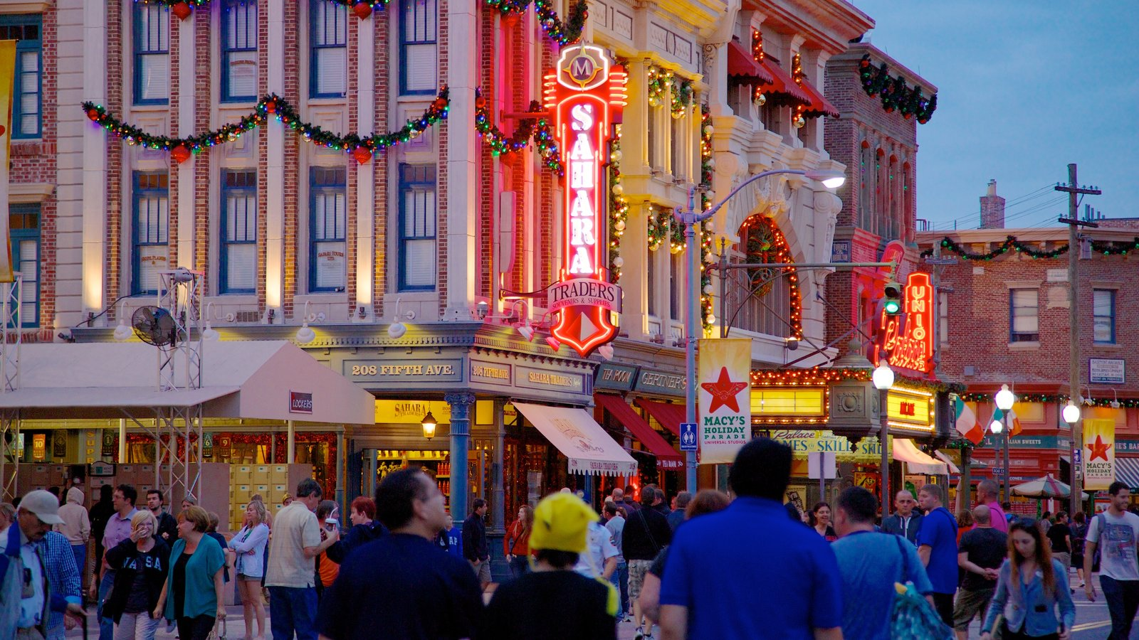 Universal Studios Orlando showing a city, rides and night scenes