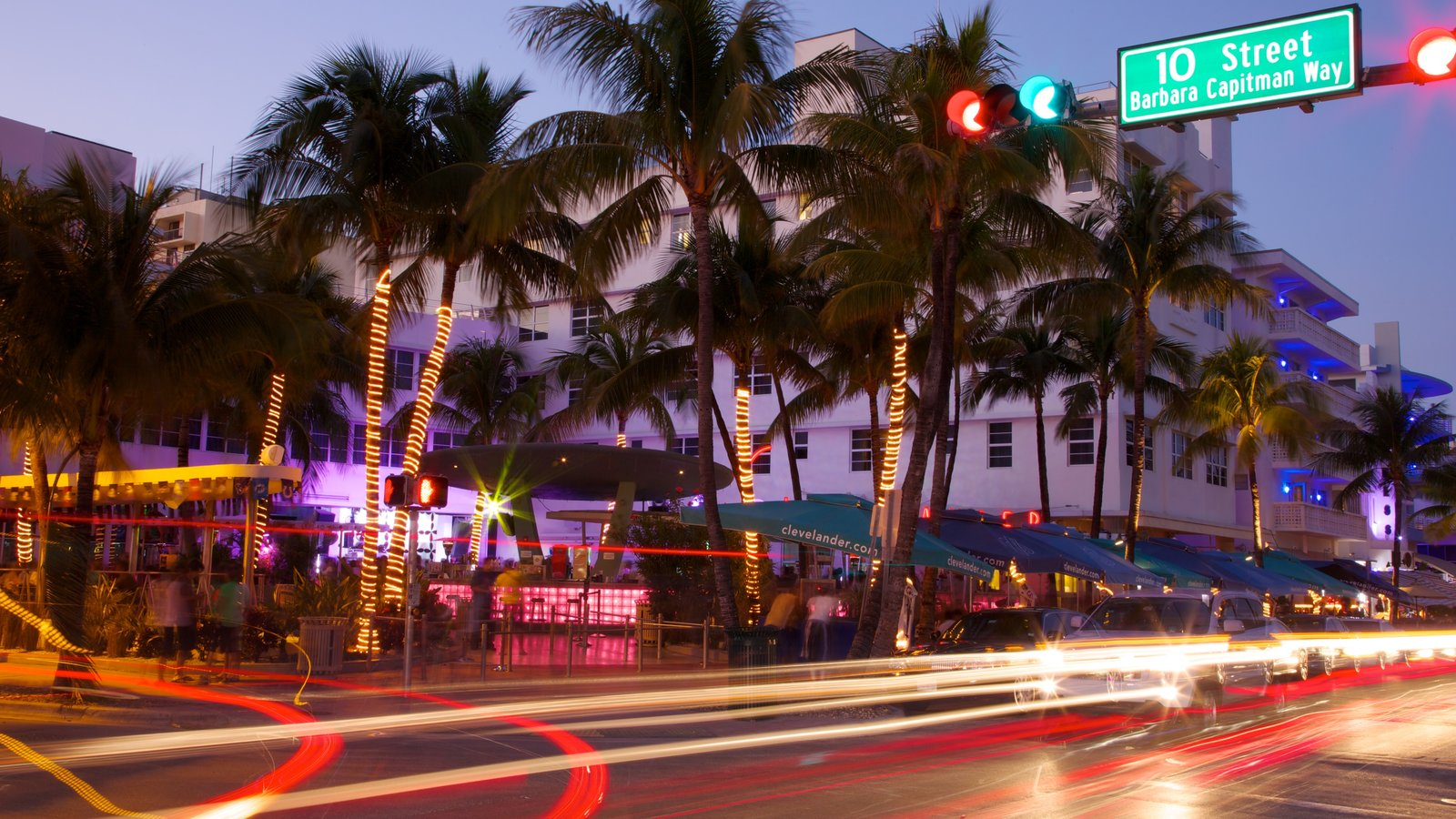 Miami Beach showing street scenes, a sunset and a city