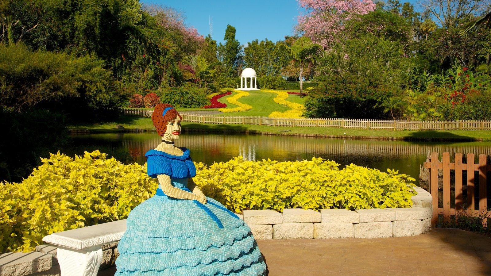 Legoland Florida which includes landscape views, a park and a pond