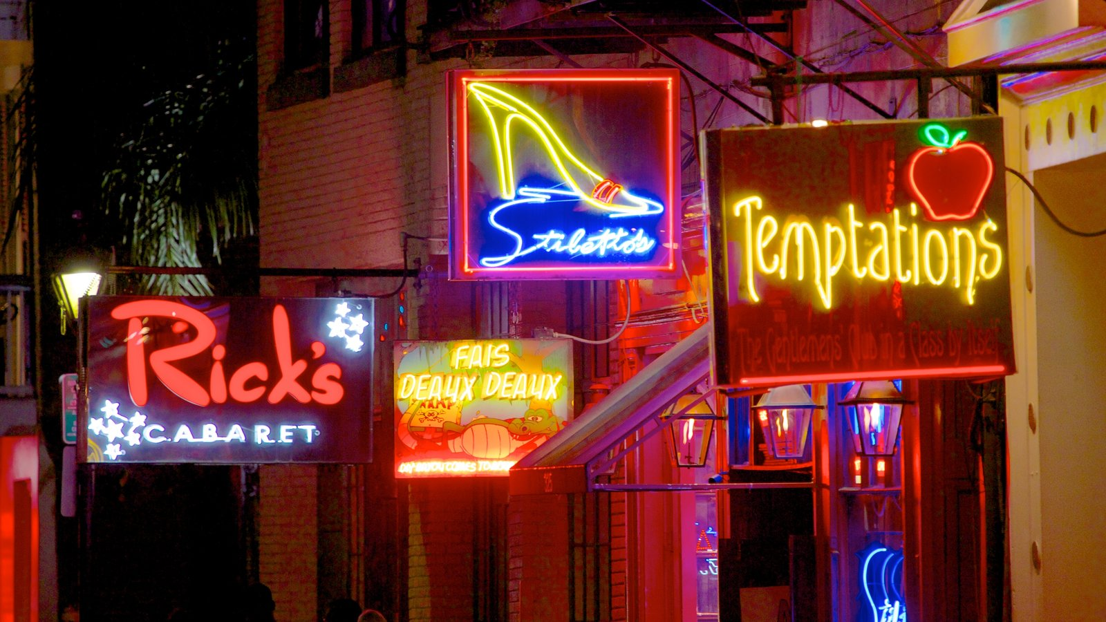 Bourbon Street featuring night scenes, street scenes and signage
