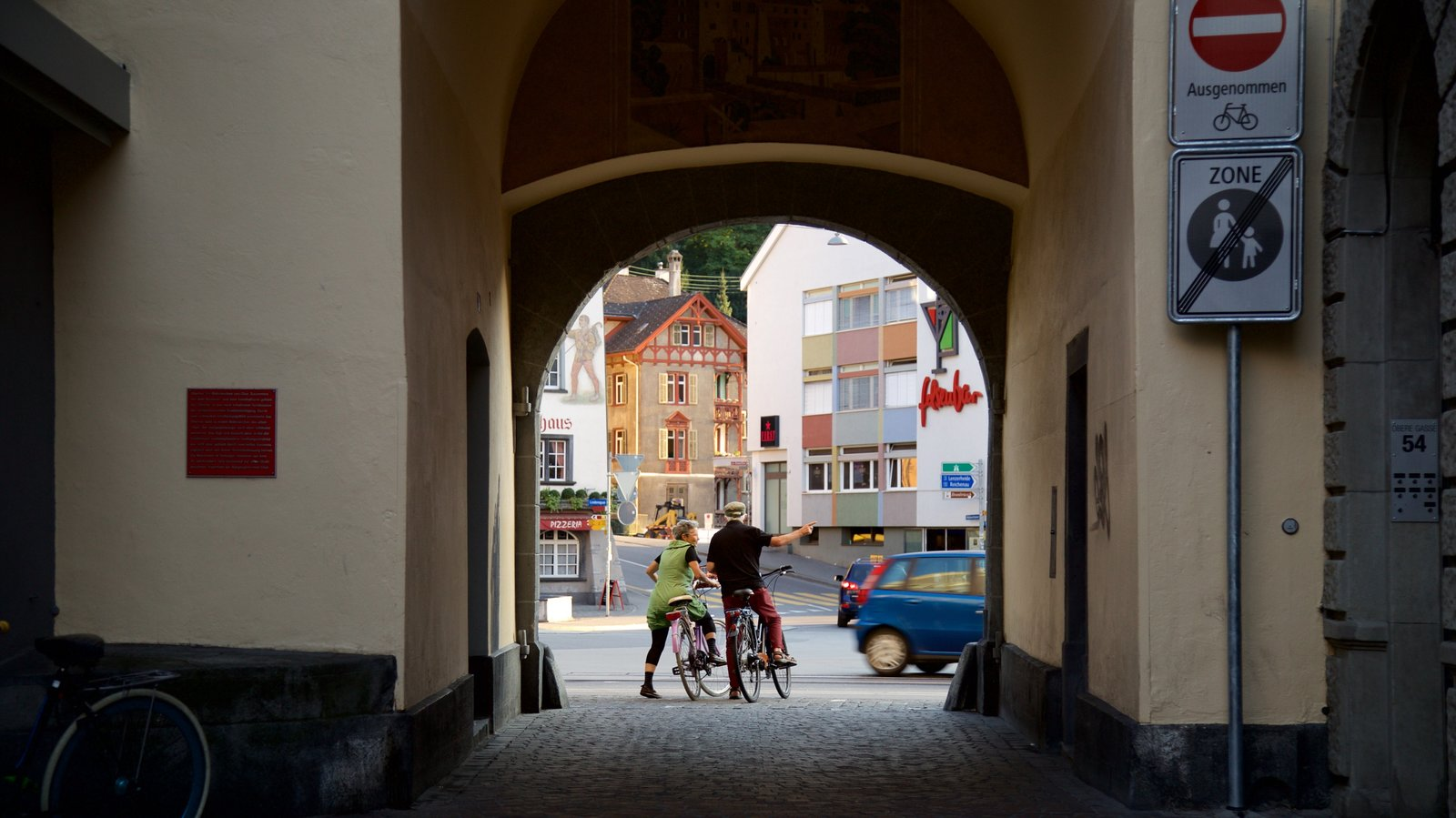 Obertor Building showing cycling as well as a couple