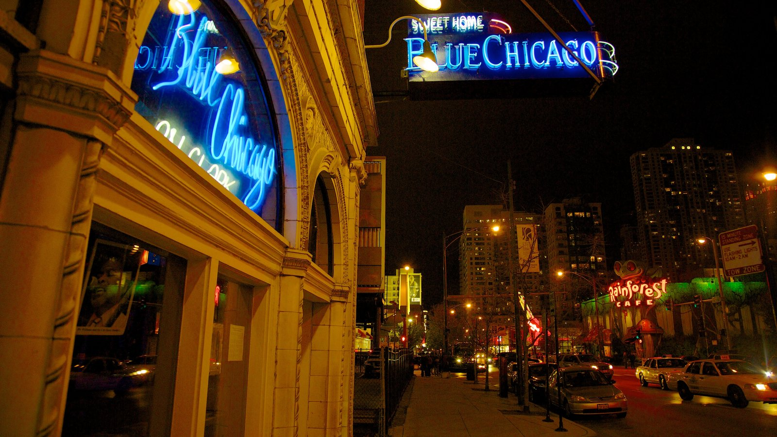 Magnificent Mile - River North showing night scenes, a city and signage