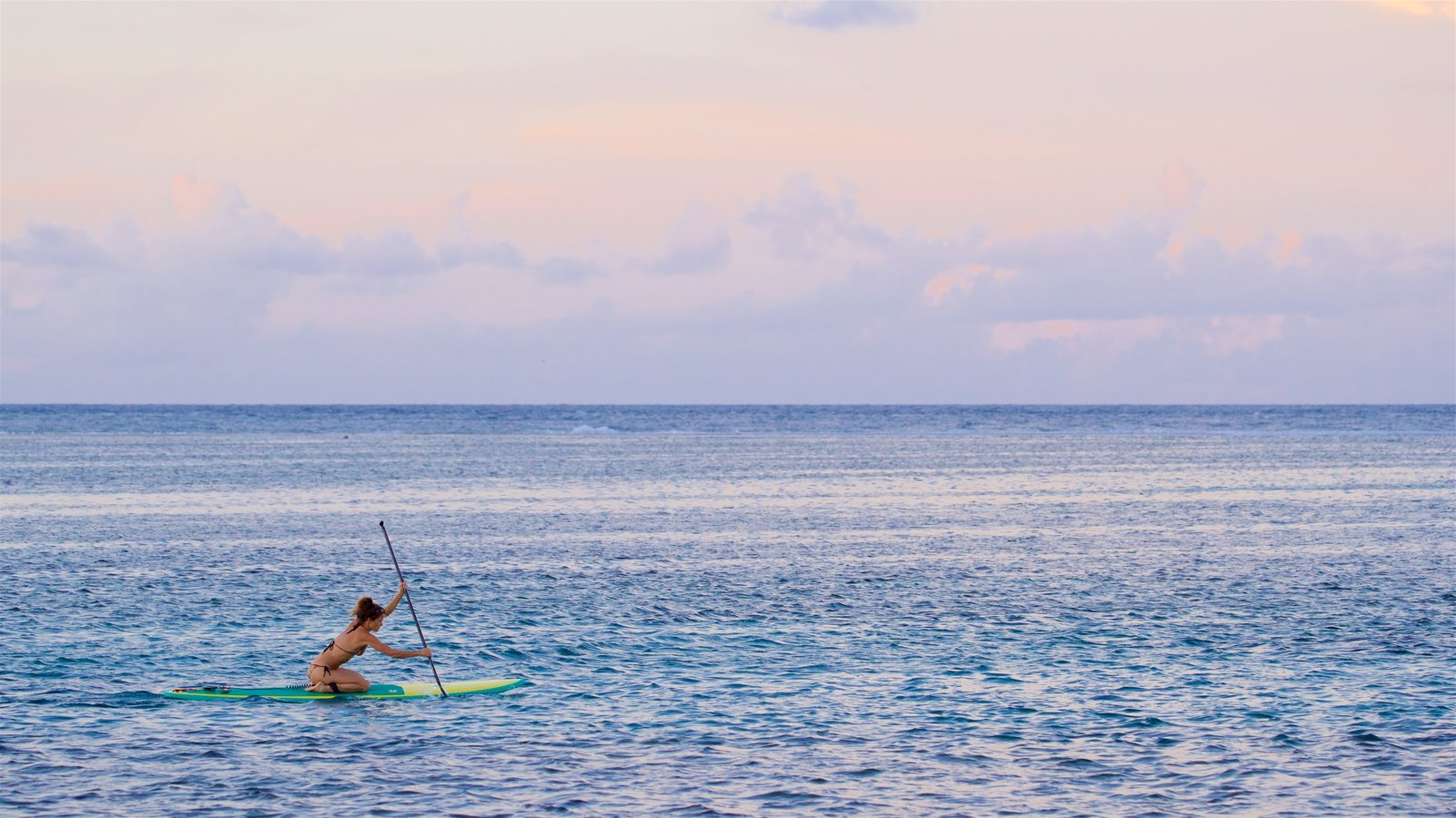 Tahiti featuring general coastal views, a sunset and kayaking or canoeing