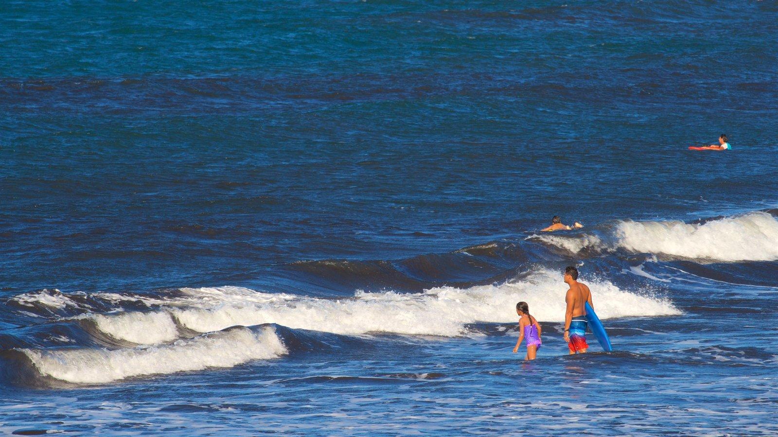 Tahiti featuring swimming, surf and general coastal views