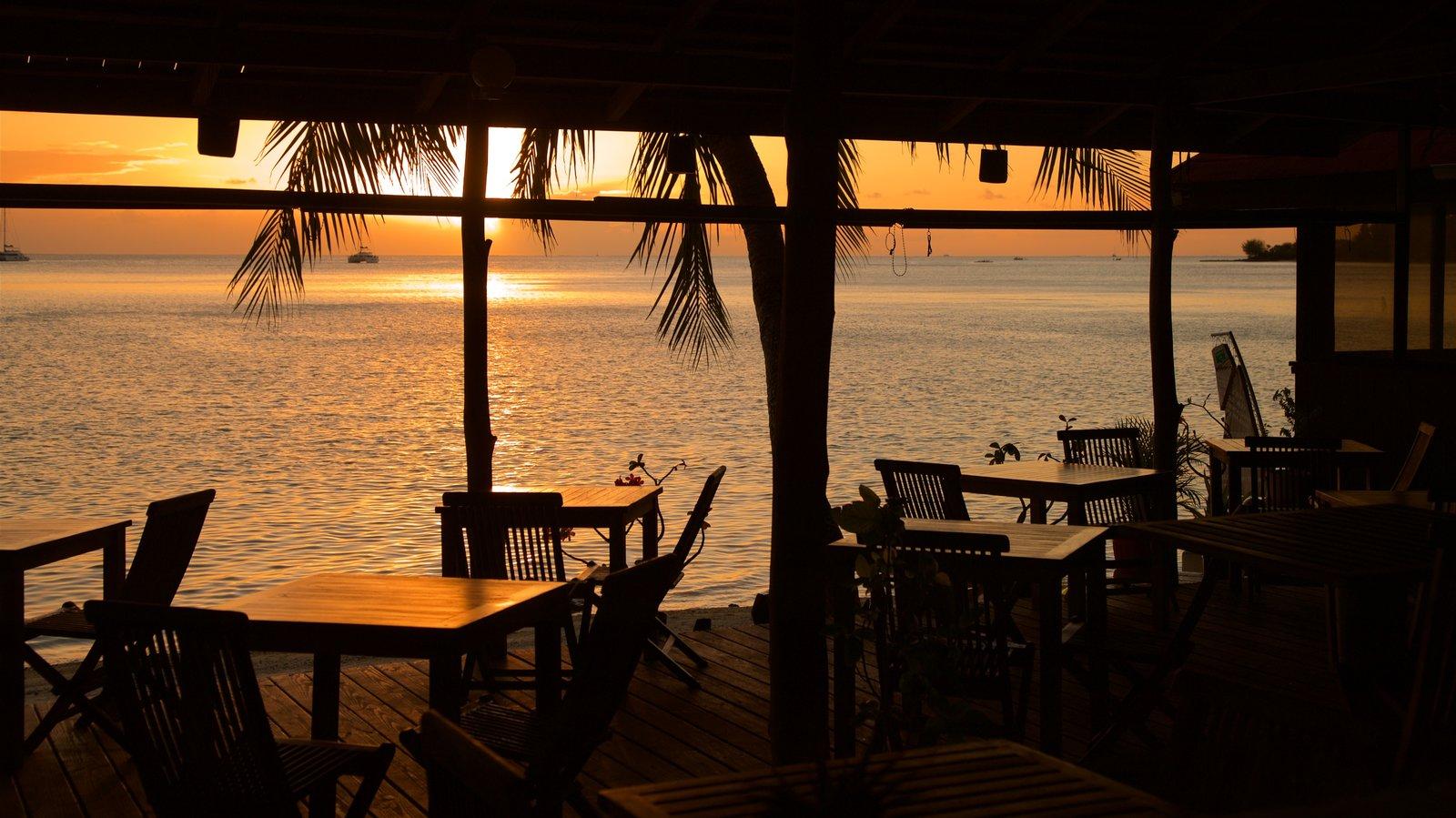Matira Beach featuring a sunset, general coastal views and interior views