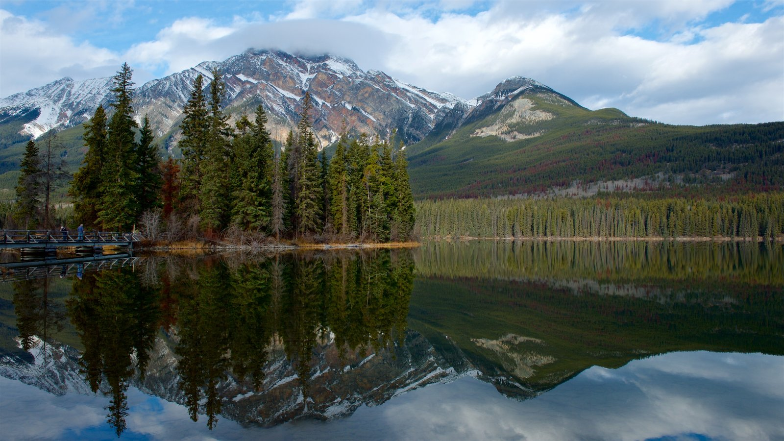 Jasper National Park which includes mountains, a river or creek and tranquil scenes
