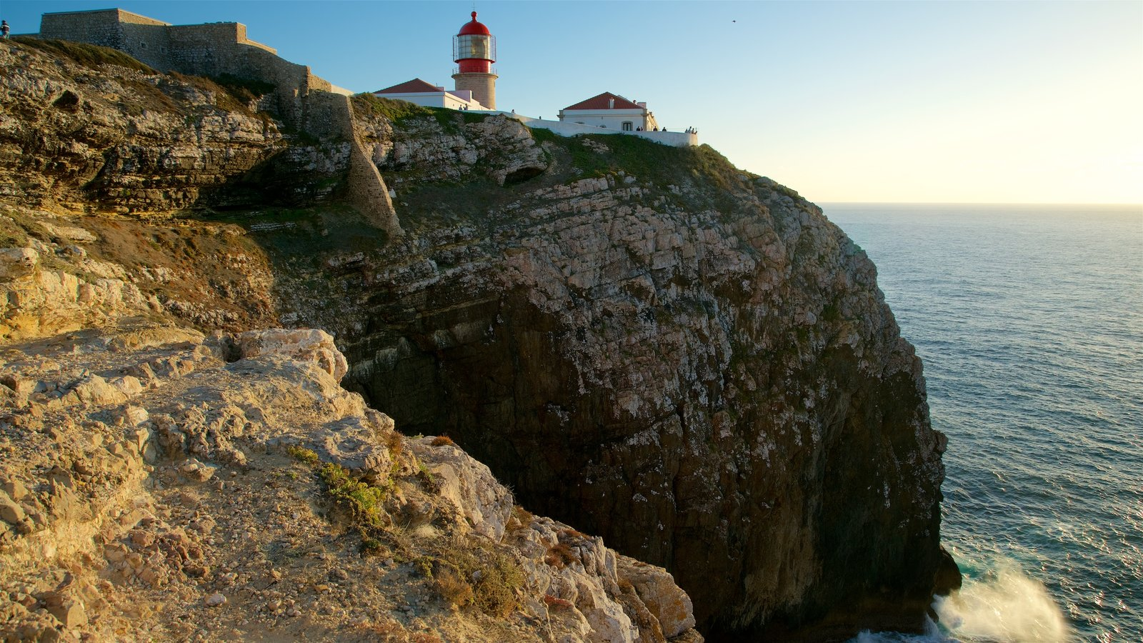 Cape St. Vincent Lighthouse which includes a lighthouse, general coastal views and rocky coastline