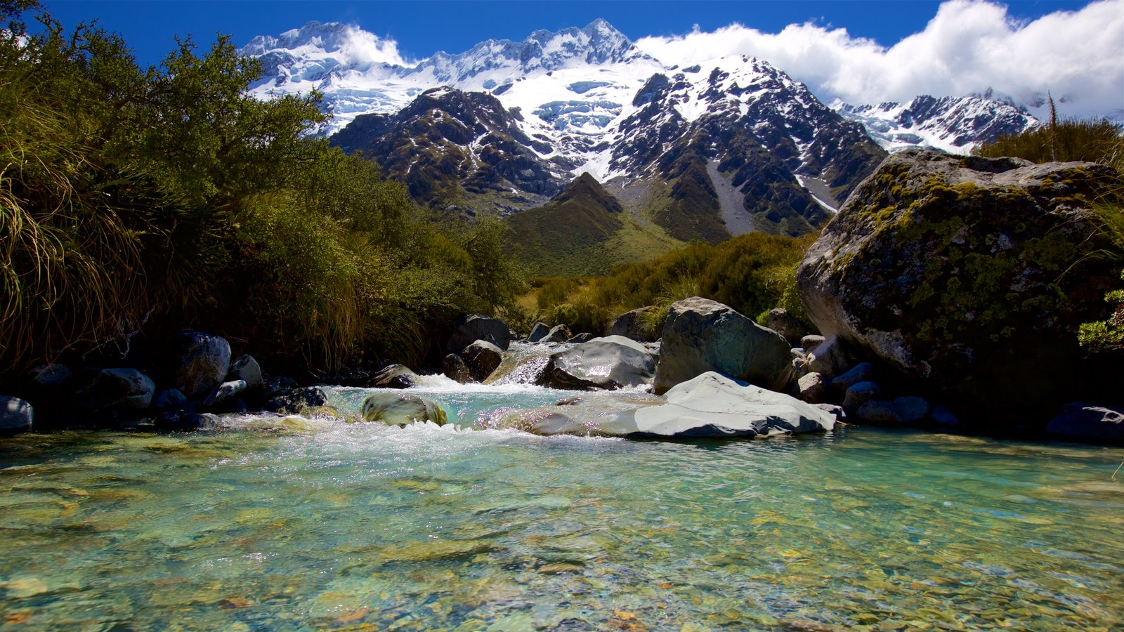 Mount Cook National Park which includes snow, a river or creek and mountains