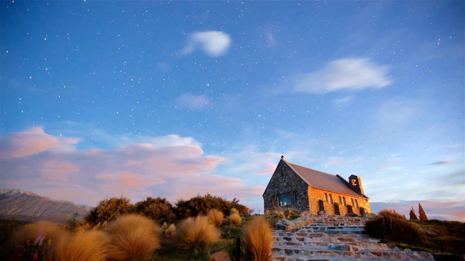Church of the Good Shepherd featuring a church or cathedral, a sunset and night scenes
