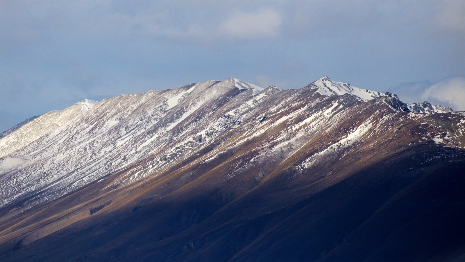 Mount John Observatory showing snow and mountains