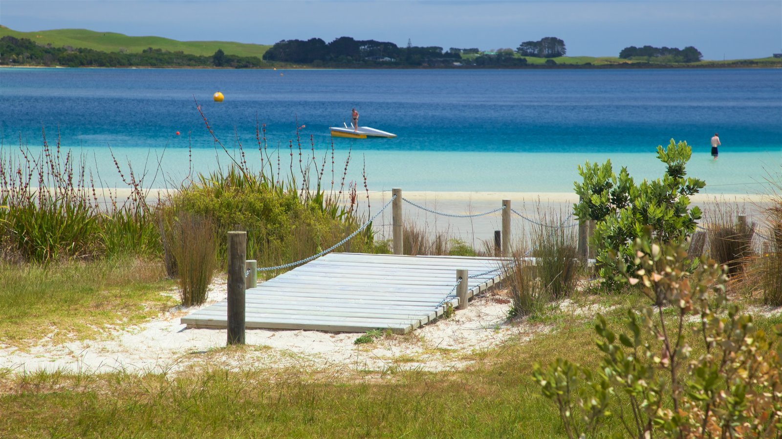 Kai Iwi Lakes featuring boating, a beach and a bay or harbor