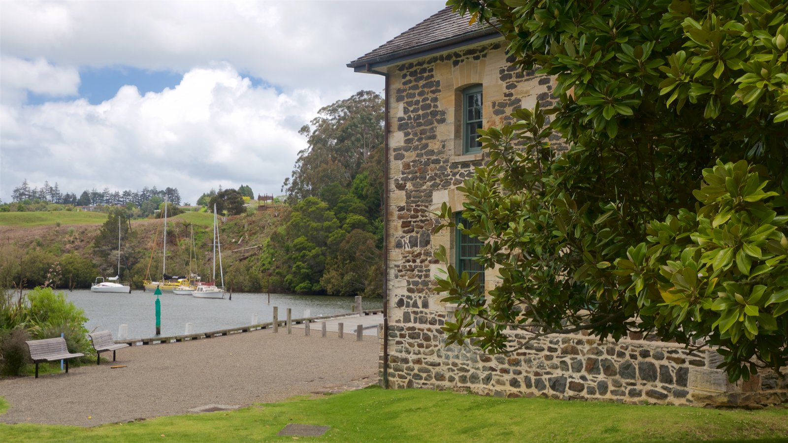 Stone Store featuring a bay or harbor and a lake or waterhole