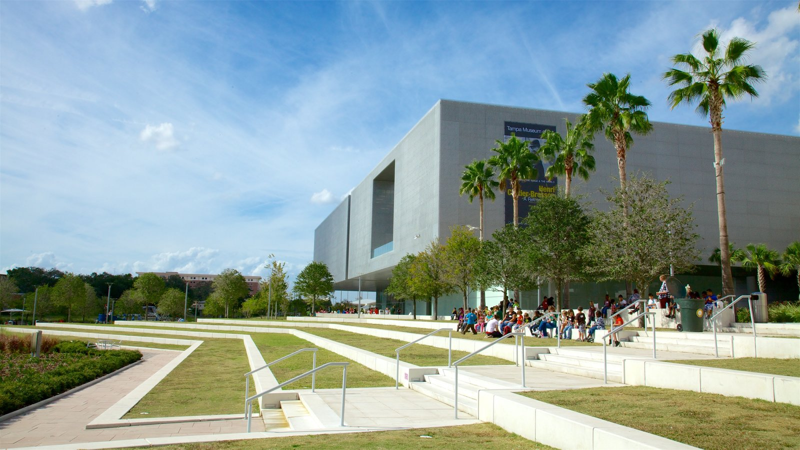 Tampa Museum of Art which includes modern architecture and a park as well as a small group of people