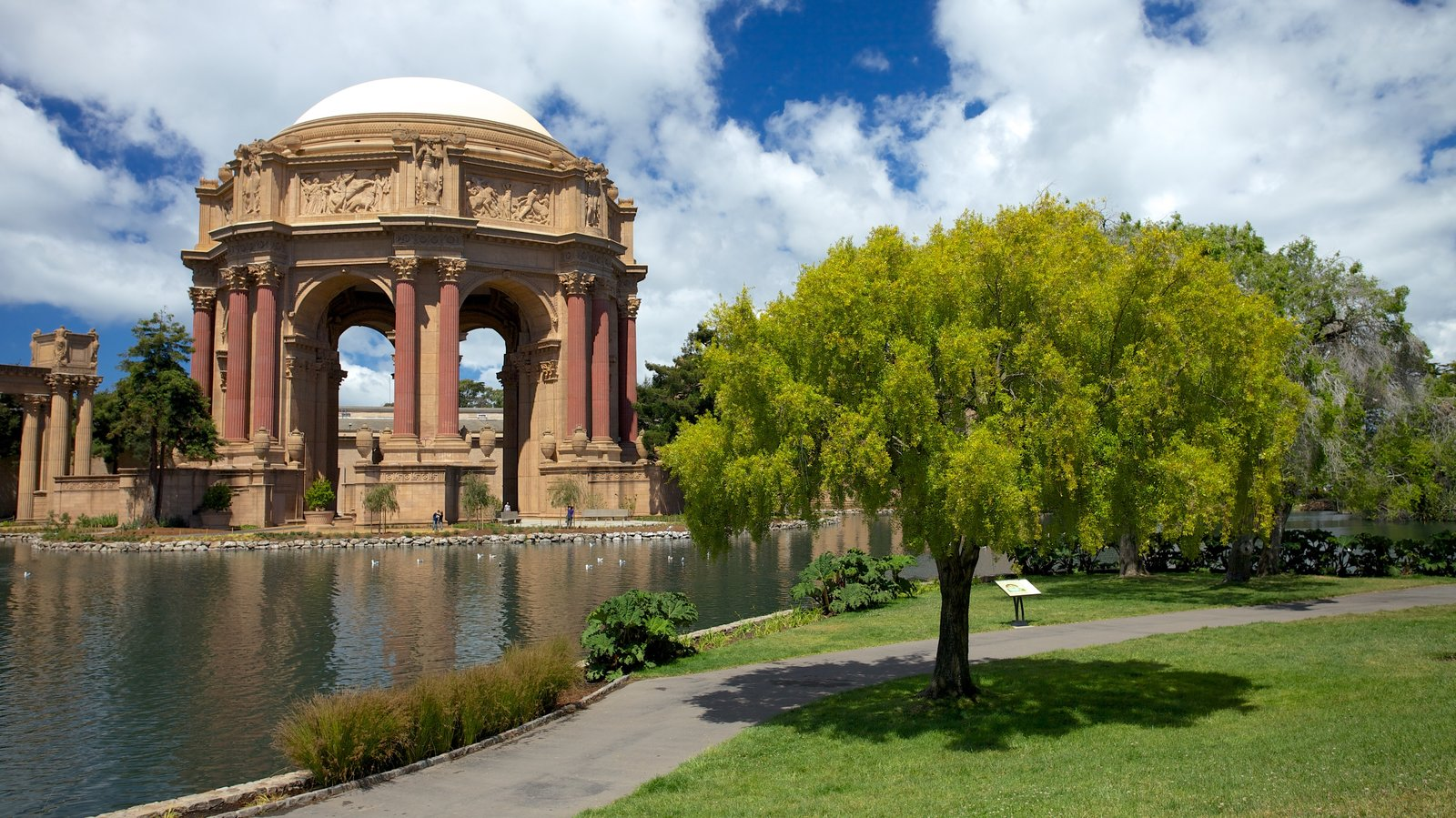 Palace of Fine Arts showing heritage architecture and a garden