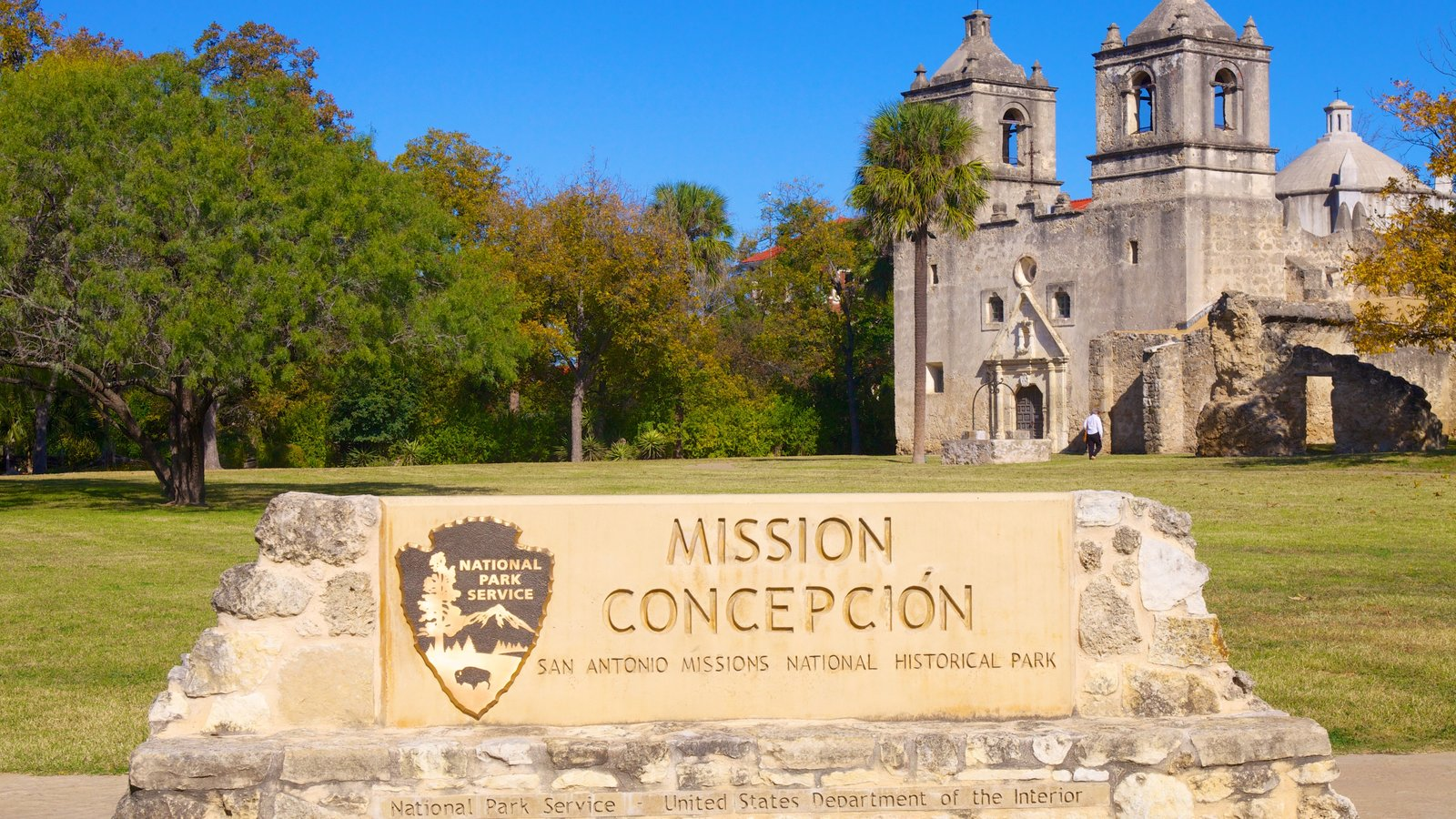 San Antonio Missions National Park showing signage, a park and heritage architecture