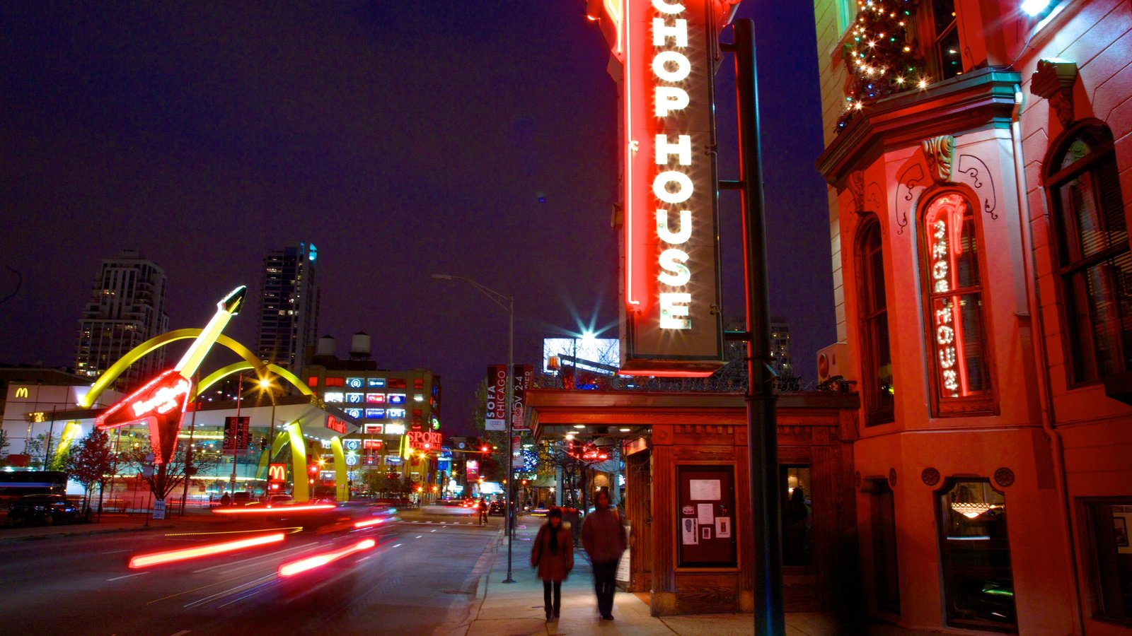 Magnificent Mile - River North showing signage, night scenes and street scenes