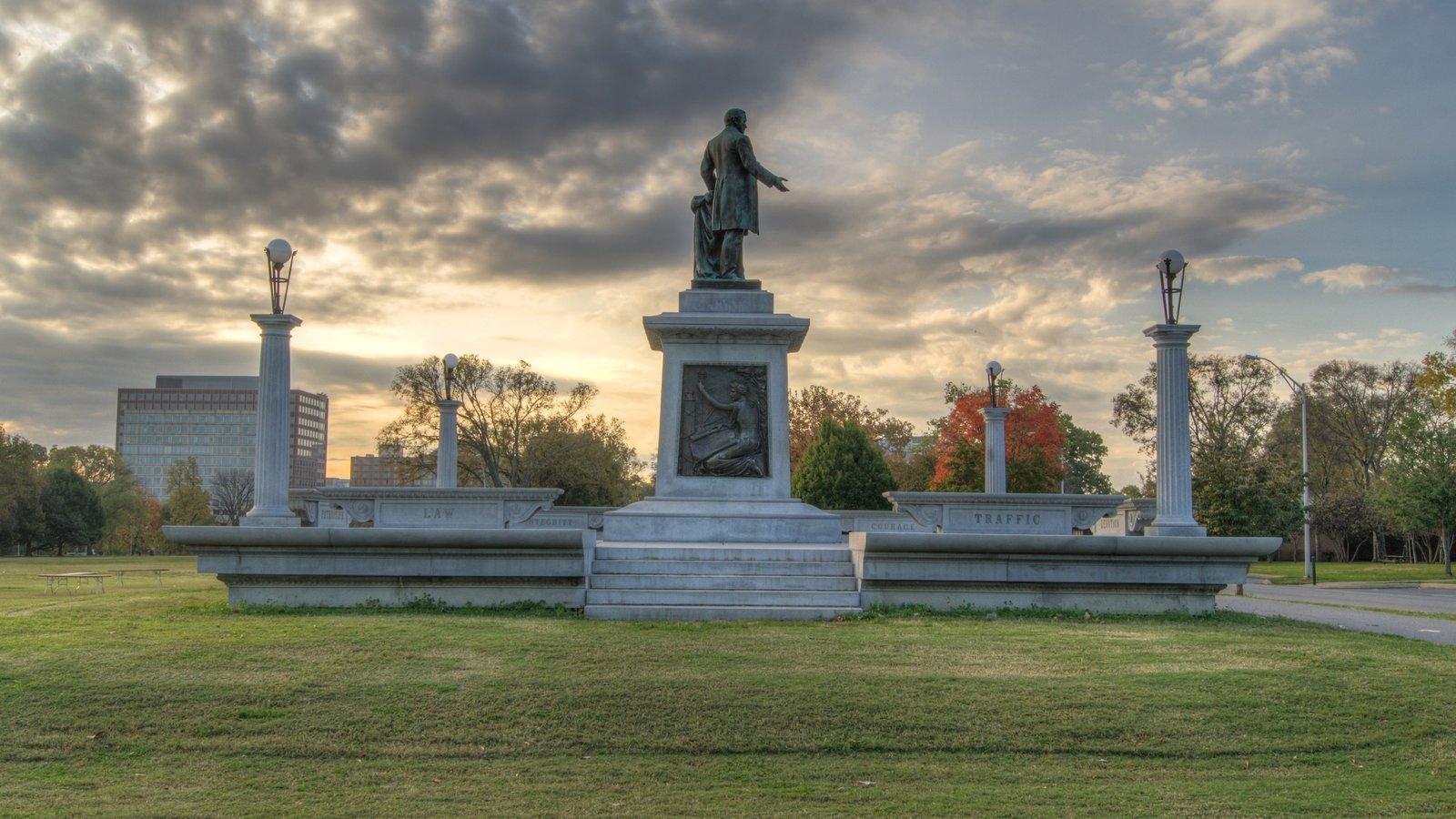 Parthenon ofreciendo un monumento, una puesta de sol y una estatua o escultura