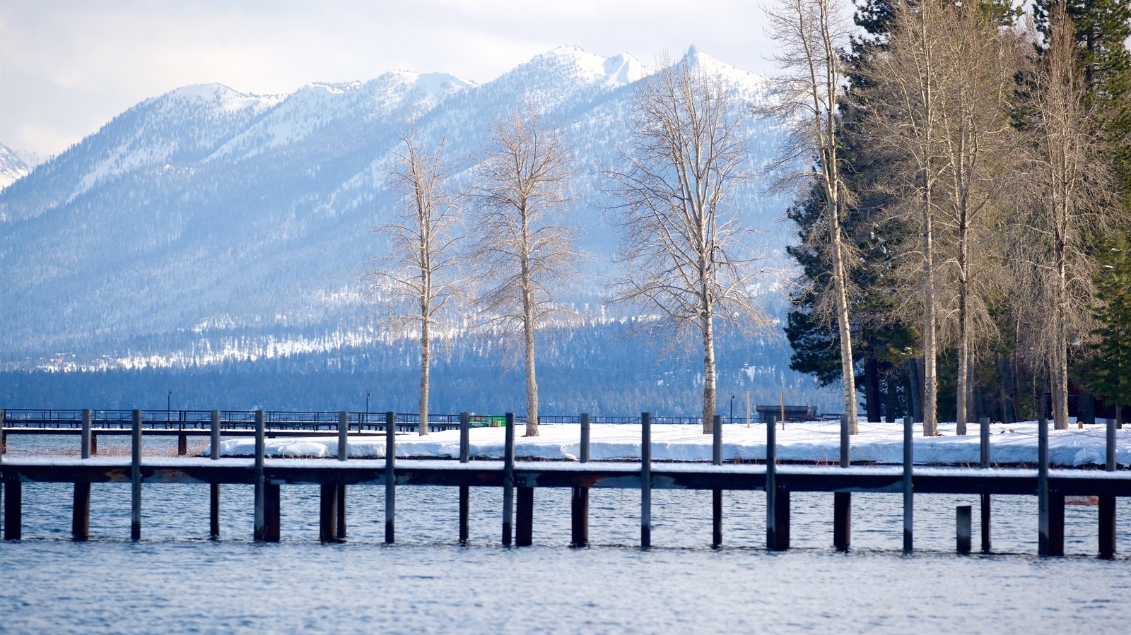 Tahoe City featuring mountains, a river or creek and snow