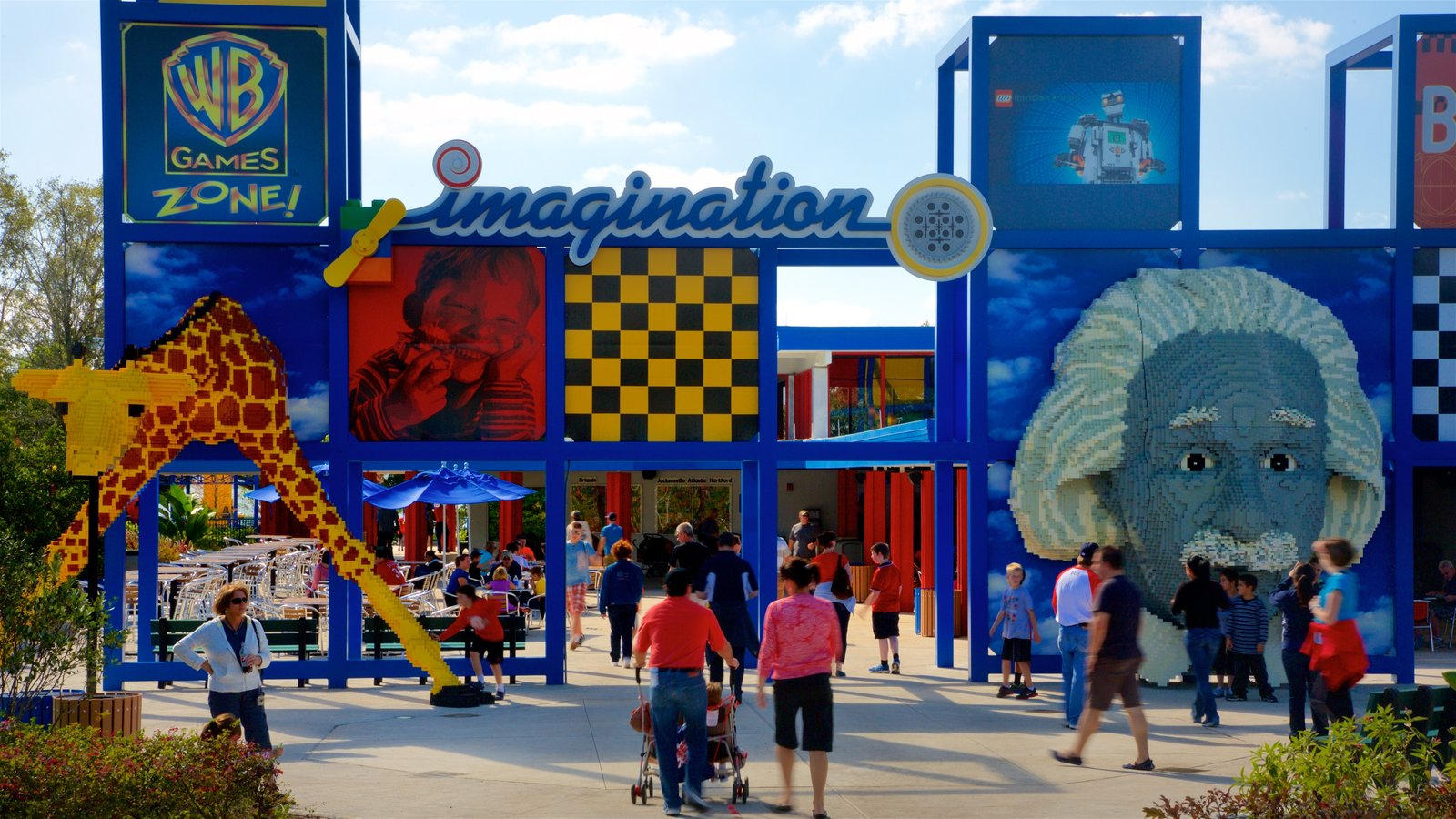 Legoland Florida showing rides as well as a small group of people