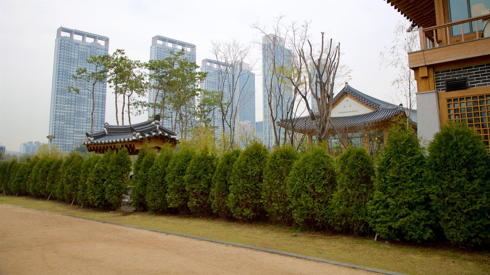 Incheon which includes a high rise building, a city and heritage elements