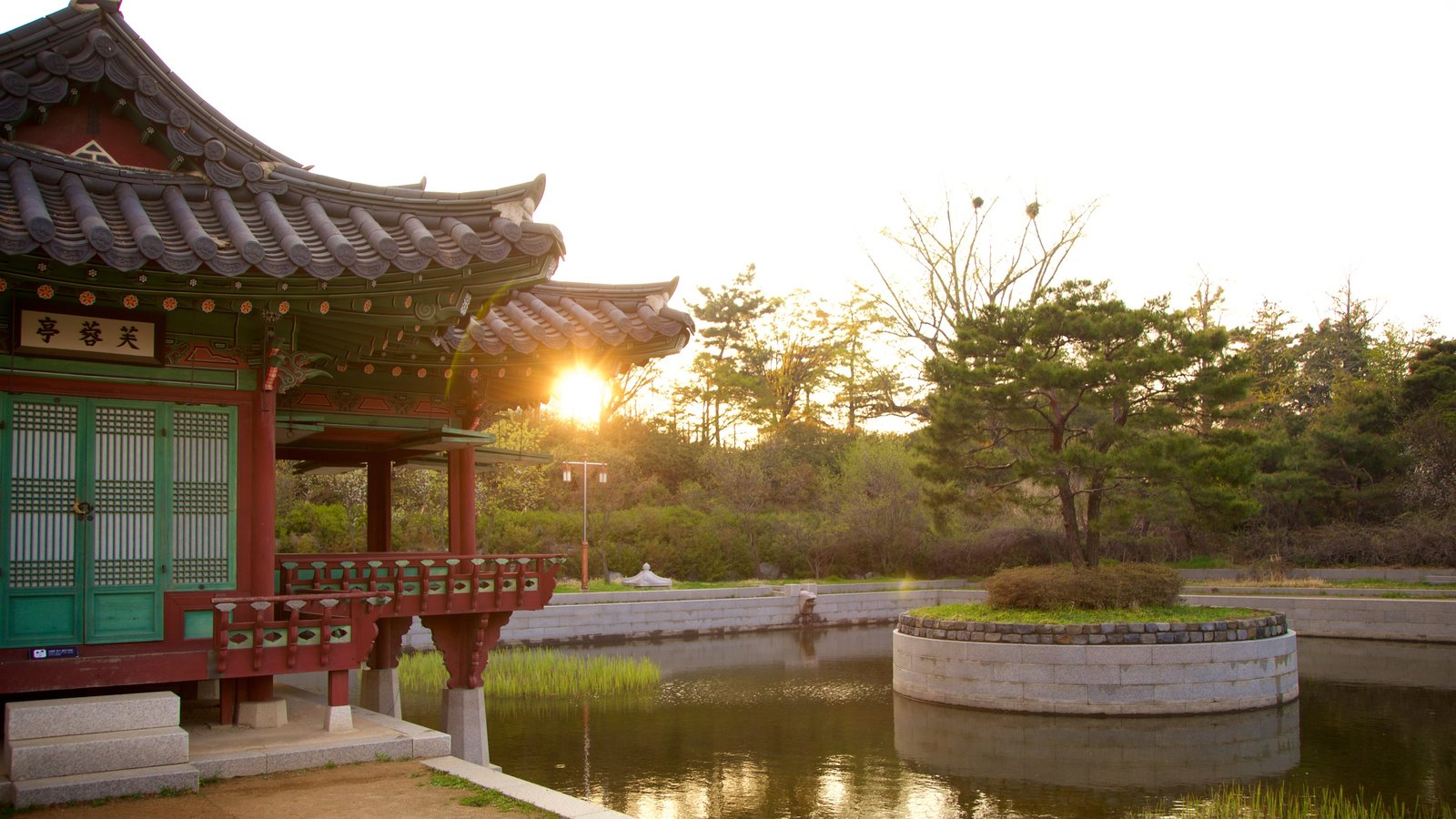 Wolmi Traditional Park which includes heritage elements, a sunset and a pond